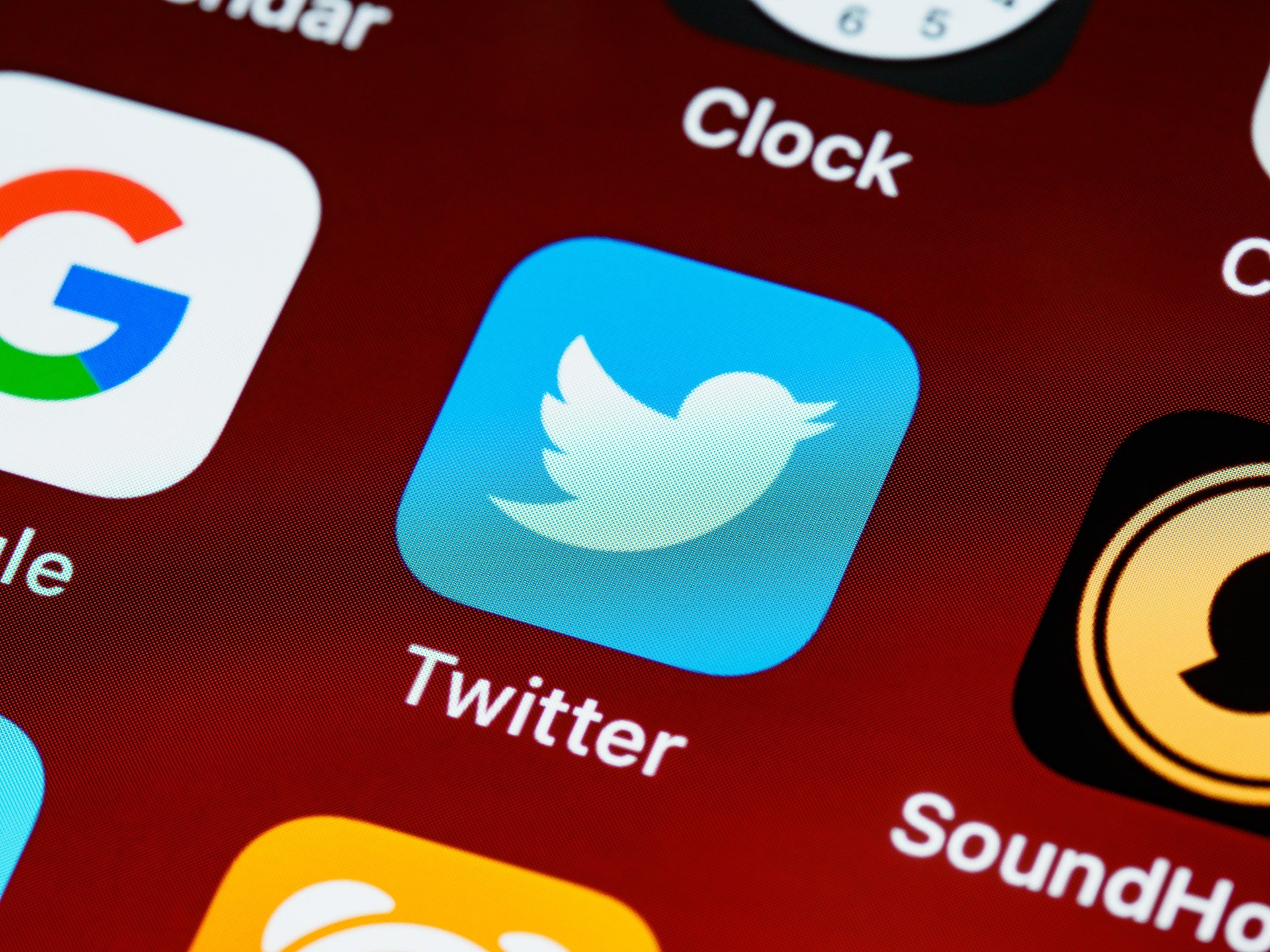 A photograph of a phone screen with Twitter on it