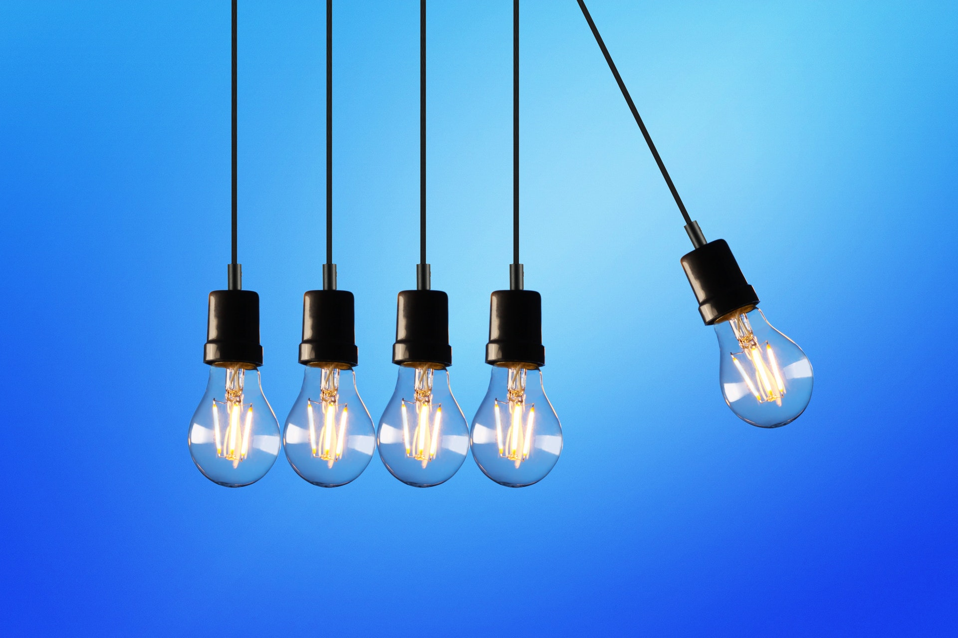 A Newton's cradle made of lightbulbs